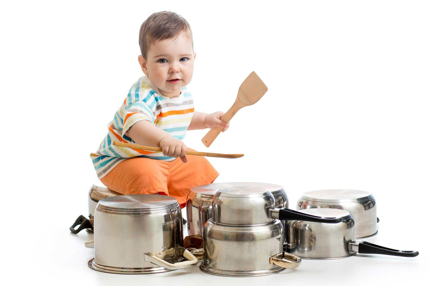 nanny/housekeepers kid plays with pots and pans